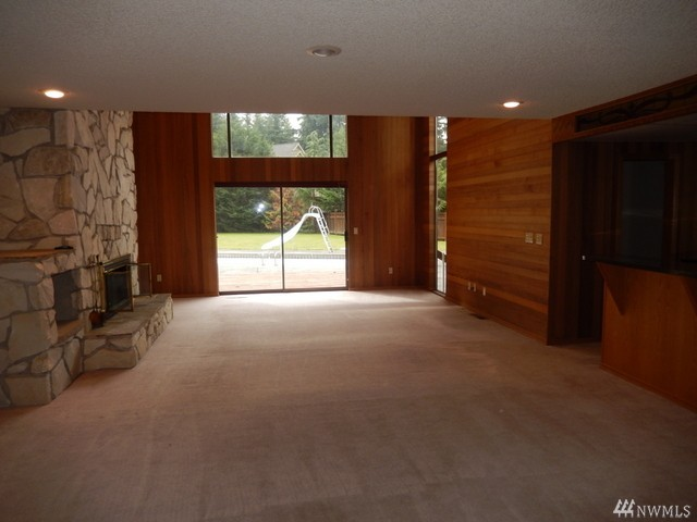 Huge house w pool in buckley heilbrun home team for Wet bar in living room